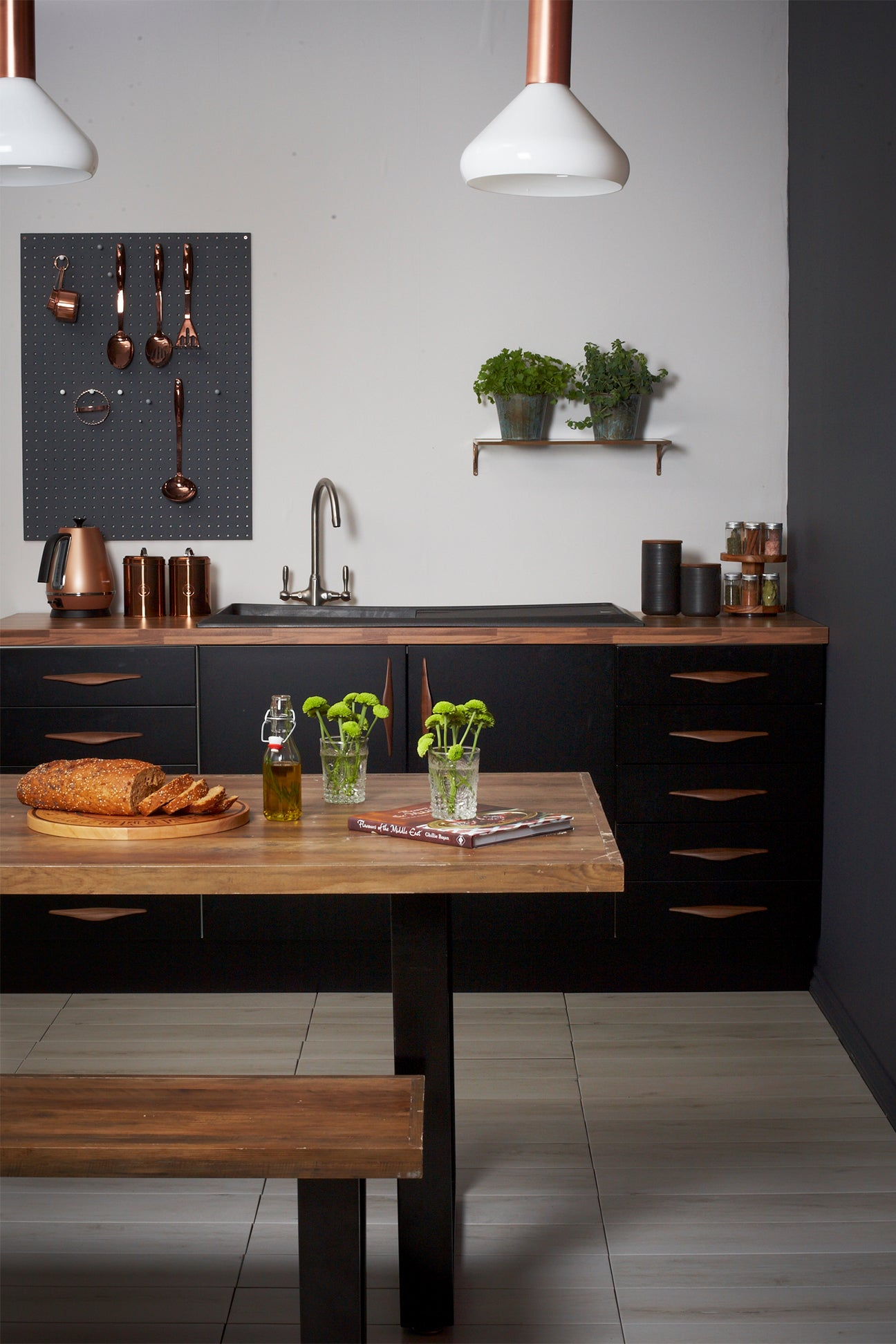 black kitchen with wooden counters