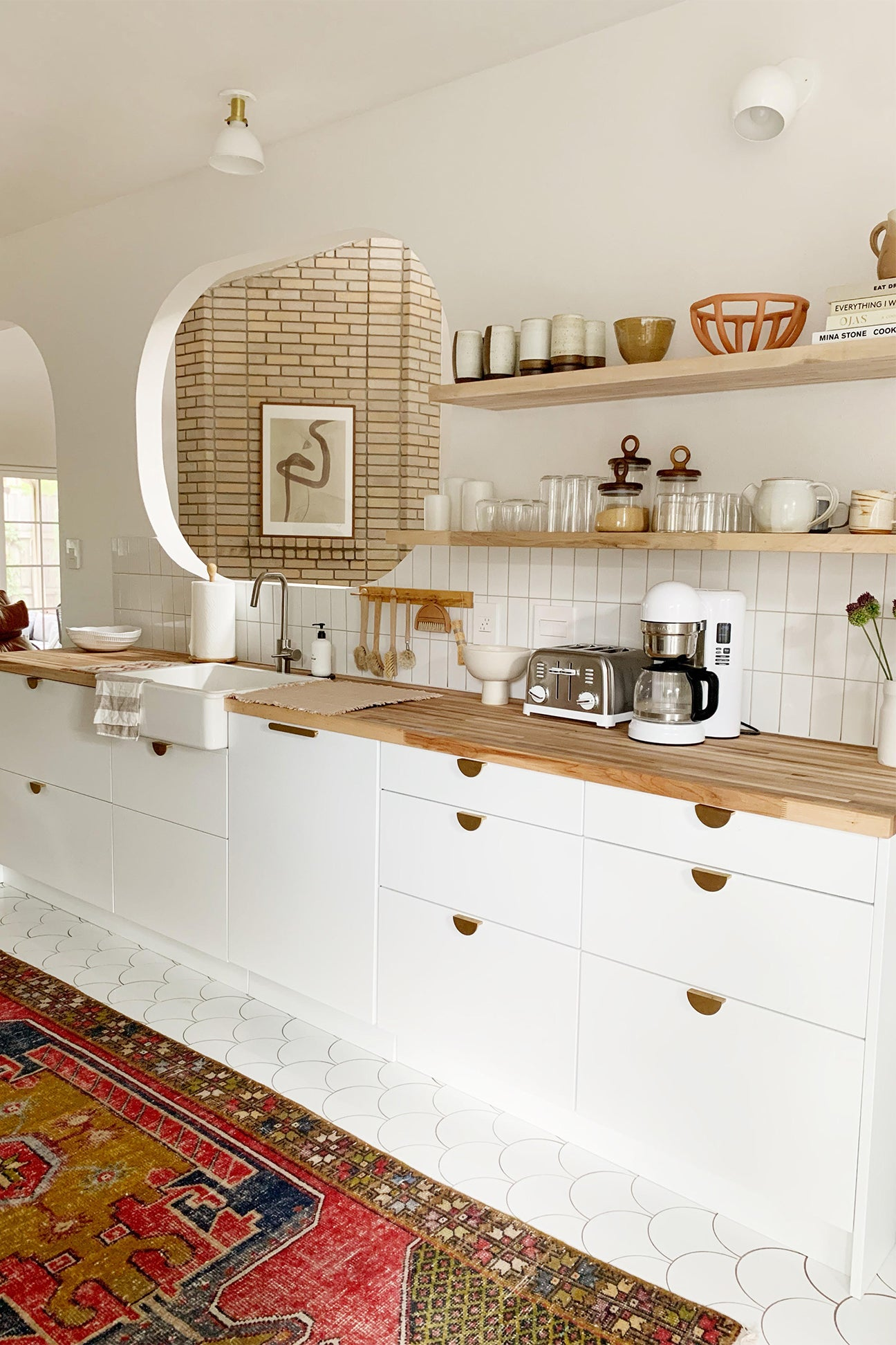 all white kitchen with wooden counters