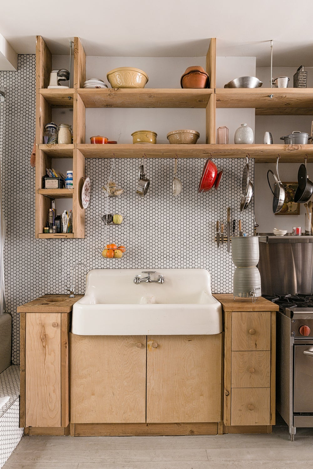 wood counters and wood shelving in kitchen