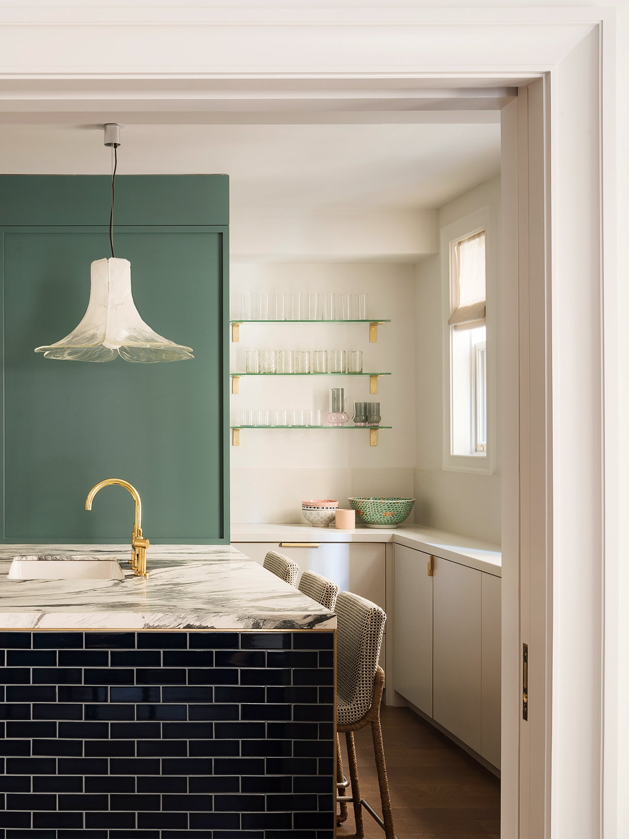 white kitchen with green accent wall