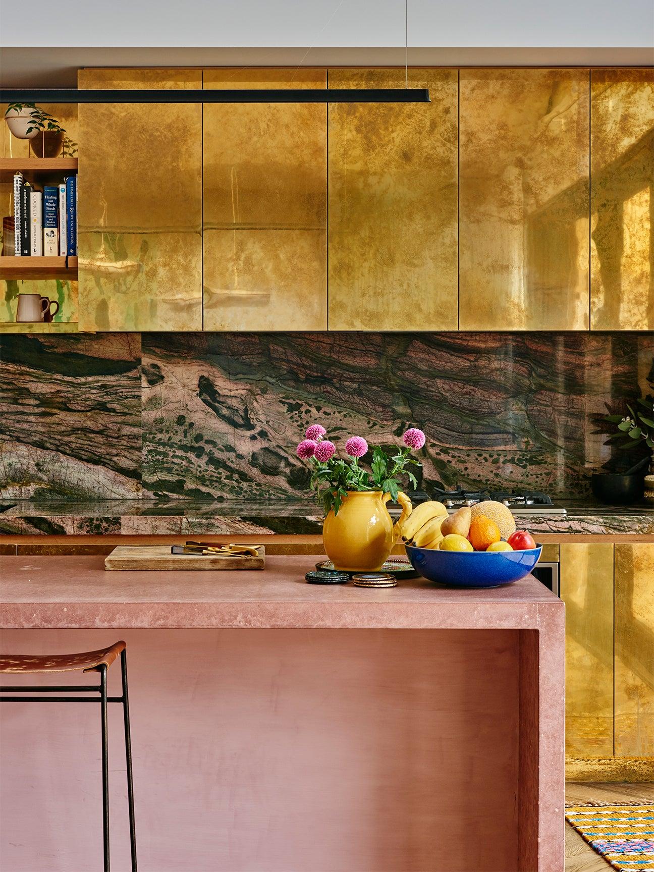 brass kitchen cabinets pink concrete island