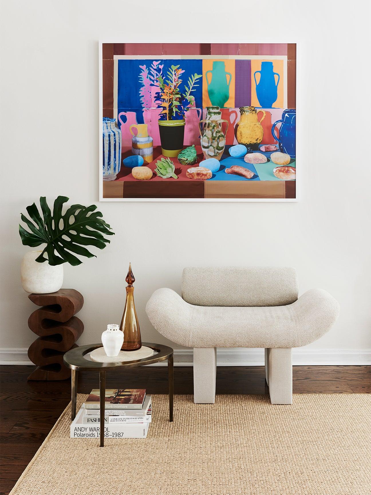 colorful artwork beige armchair