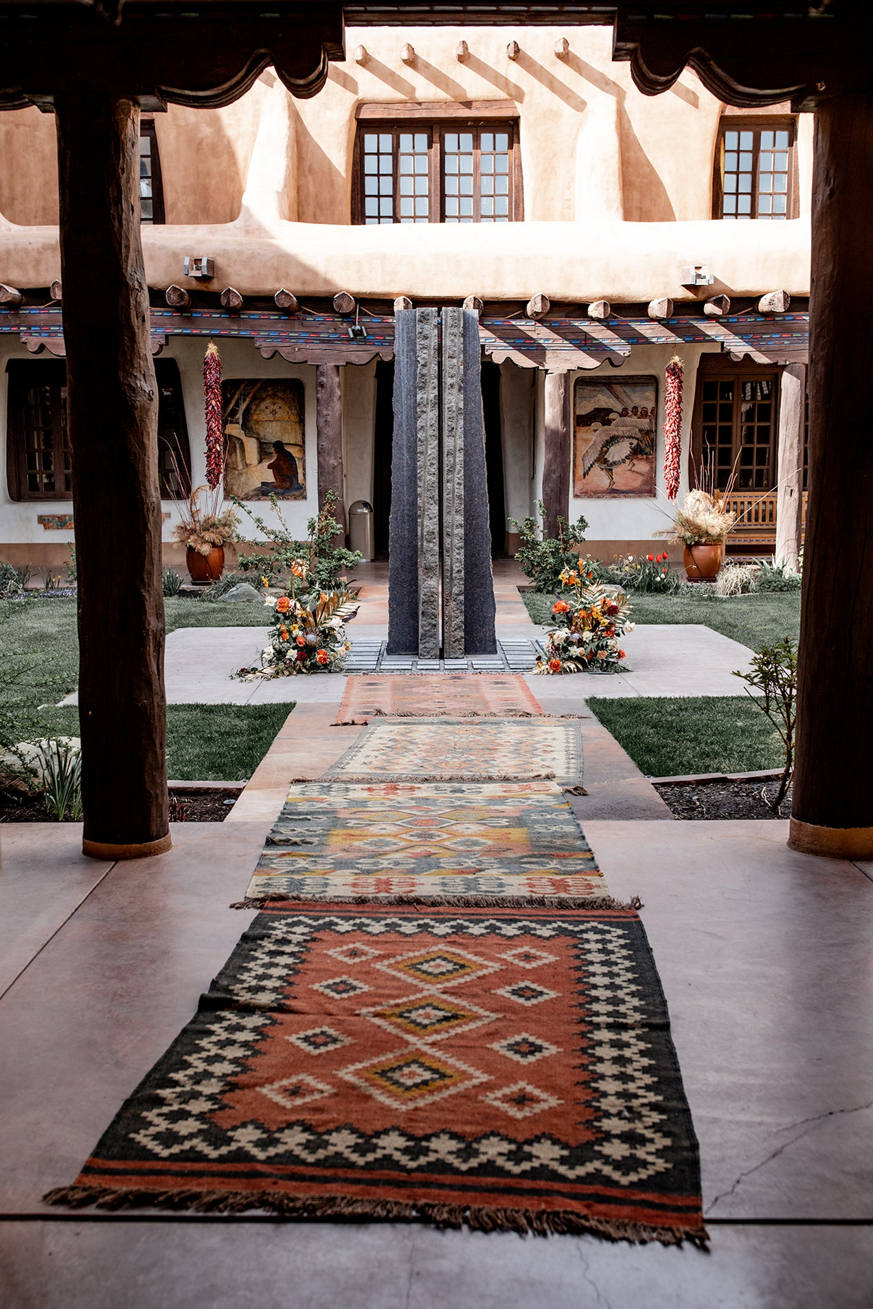 vintage rugs leading to a fountain