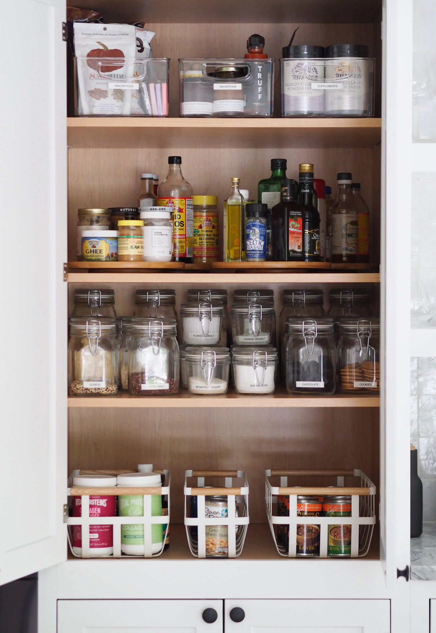 after photo of a tidy pantry cabinet with shelves