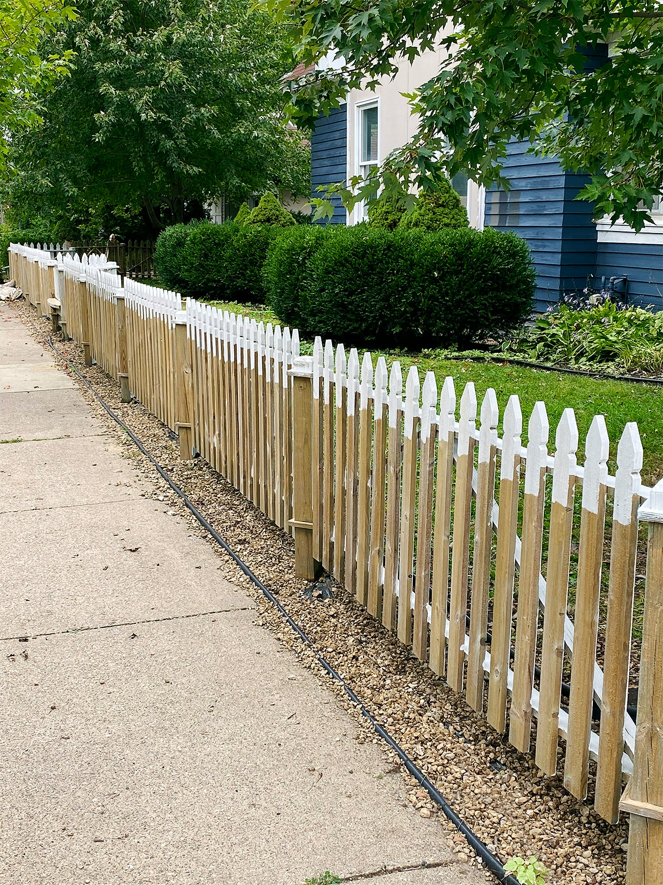 partly painted fence