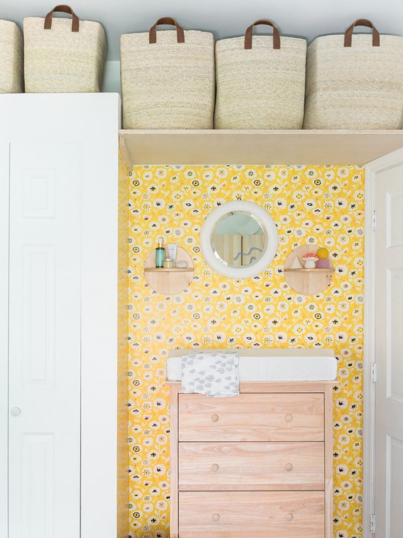 yellow wallpaper accent wall over the changing station