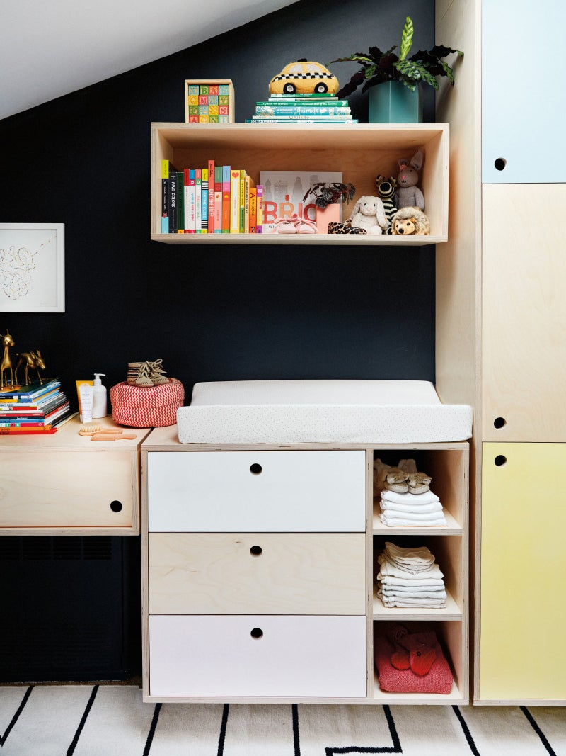 different colored built in shelving wall unit