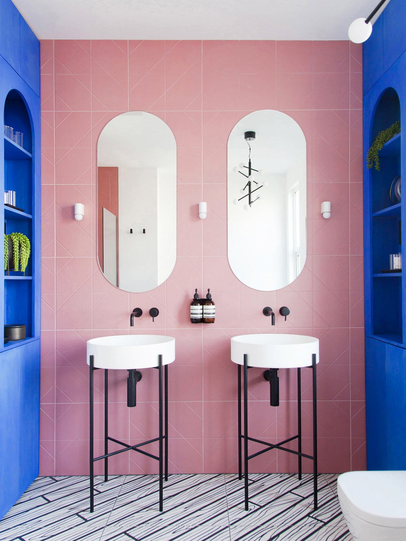 pink and blue bathroom double sinks