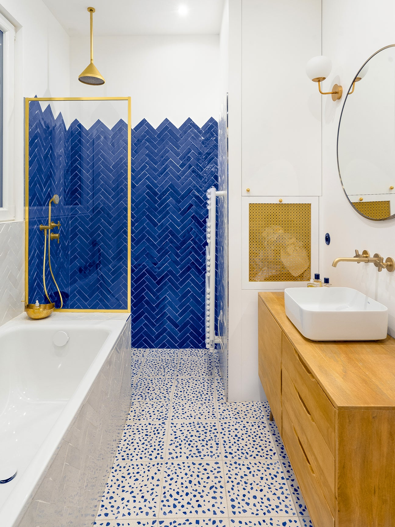 shower with blue tile pattern
