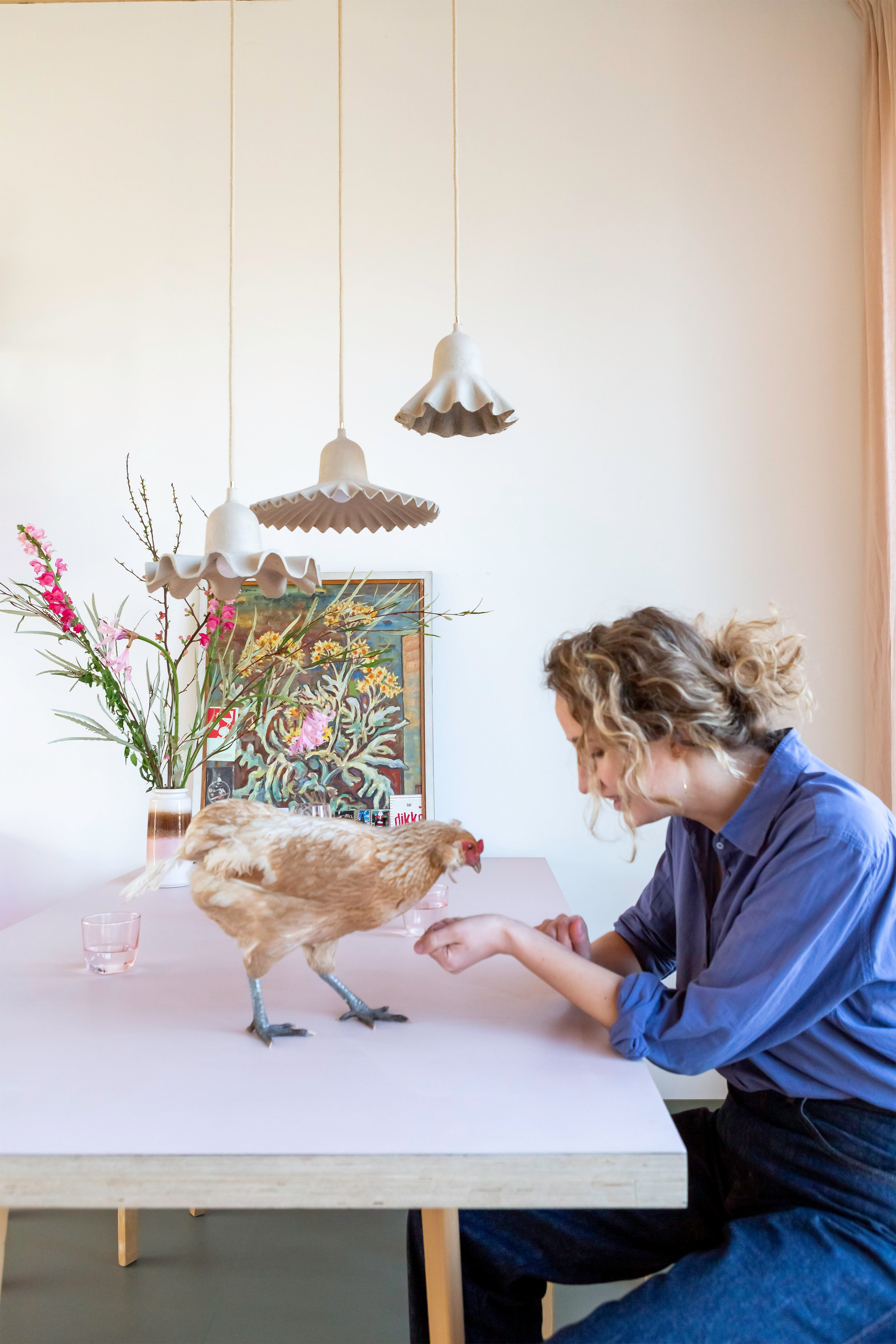 Foekje Fleur with her pet chicken