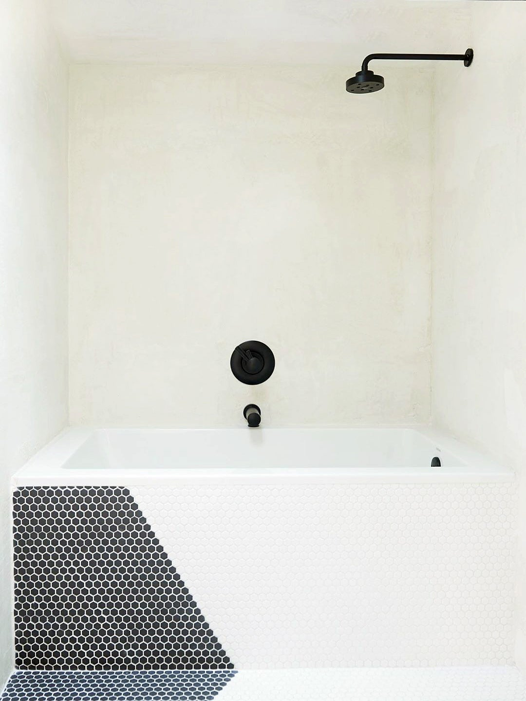 black and white bathroom with tub