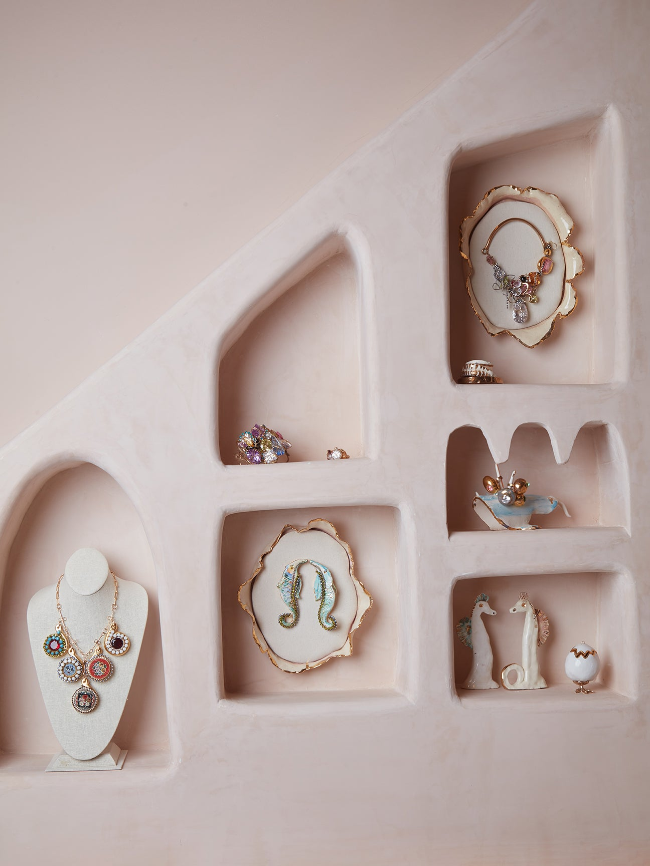 wall niches filled with pink jewelry