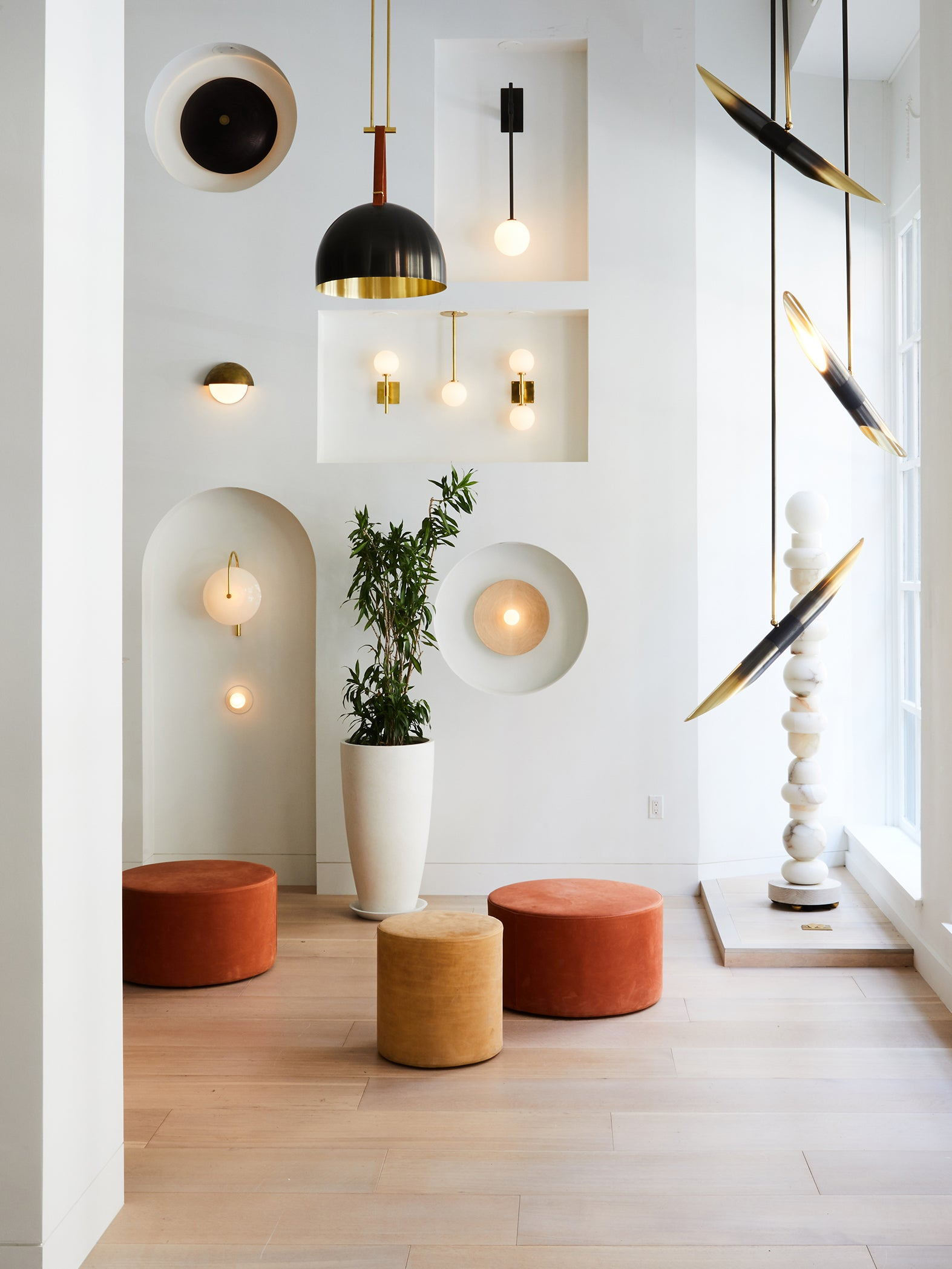 smooth wall niches filled with wall sconces