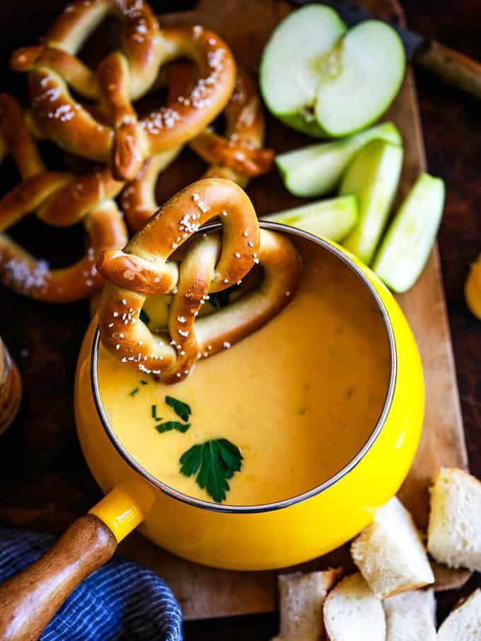 pretzels falling into cheese fondue