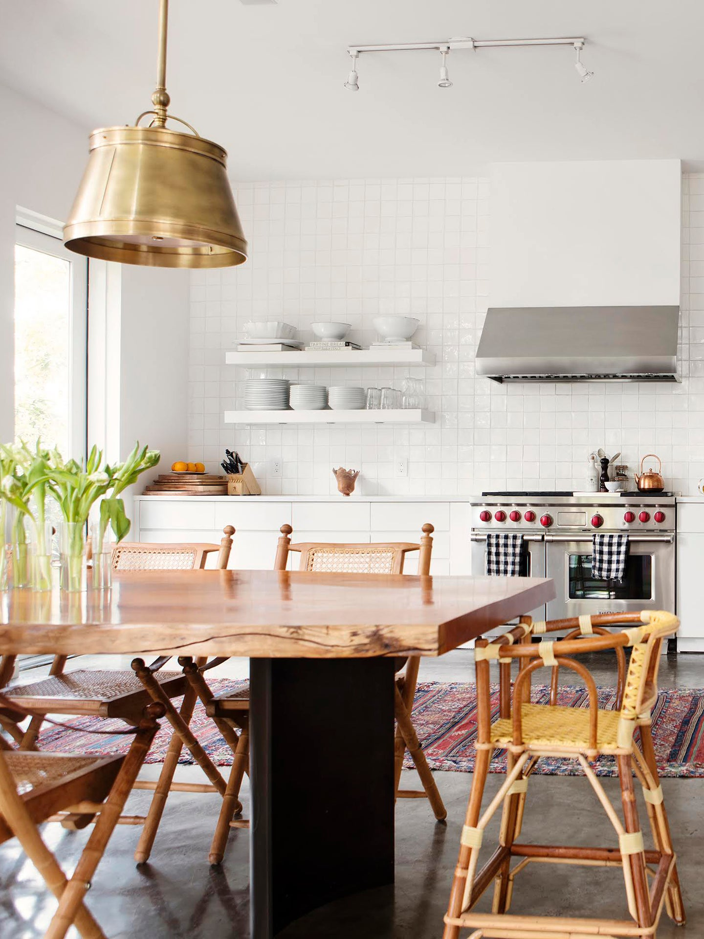 White kitchen with live edge table