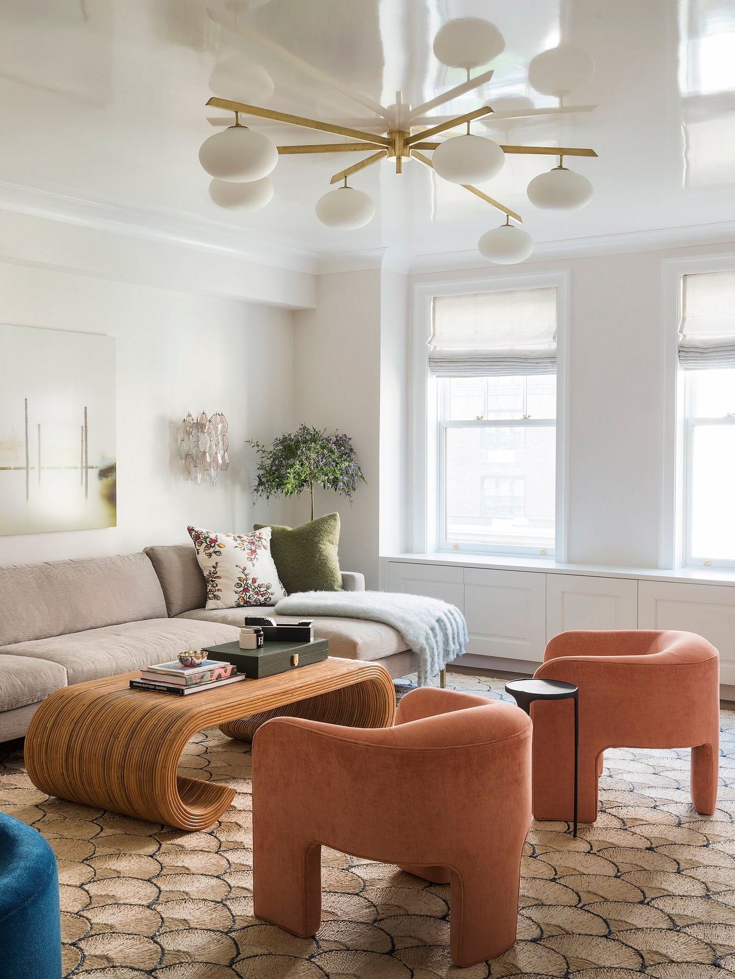 Small living room with glossy ceiling and coral chairs