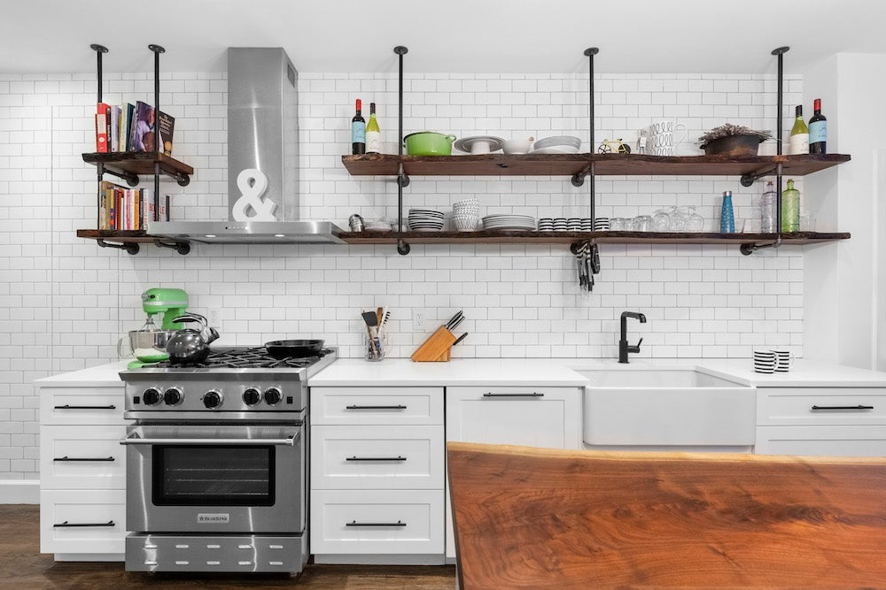White kitchen with live edge island and shelves