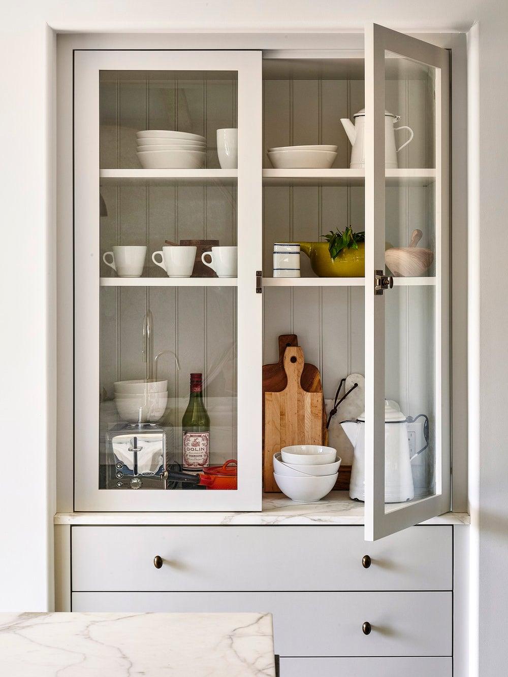 open glass pantry cupboard