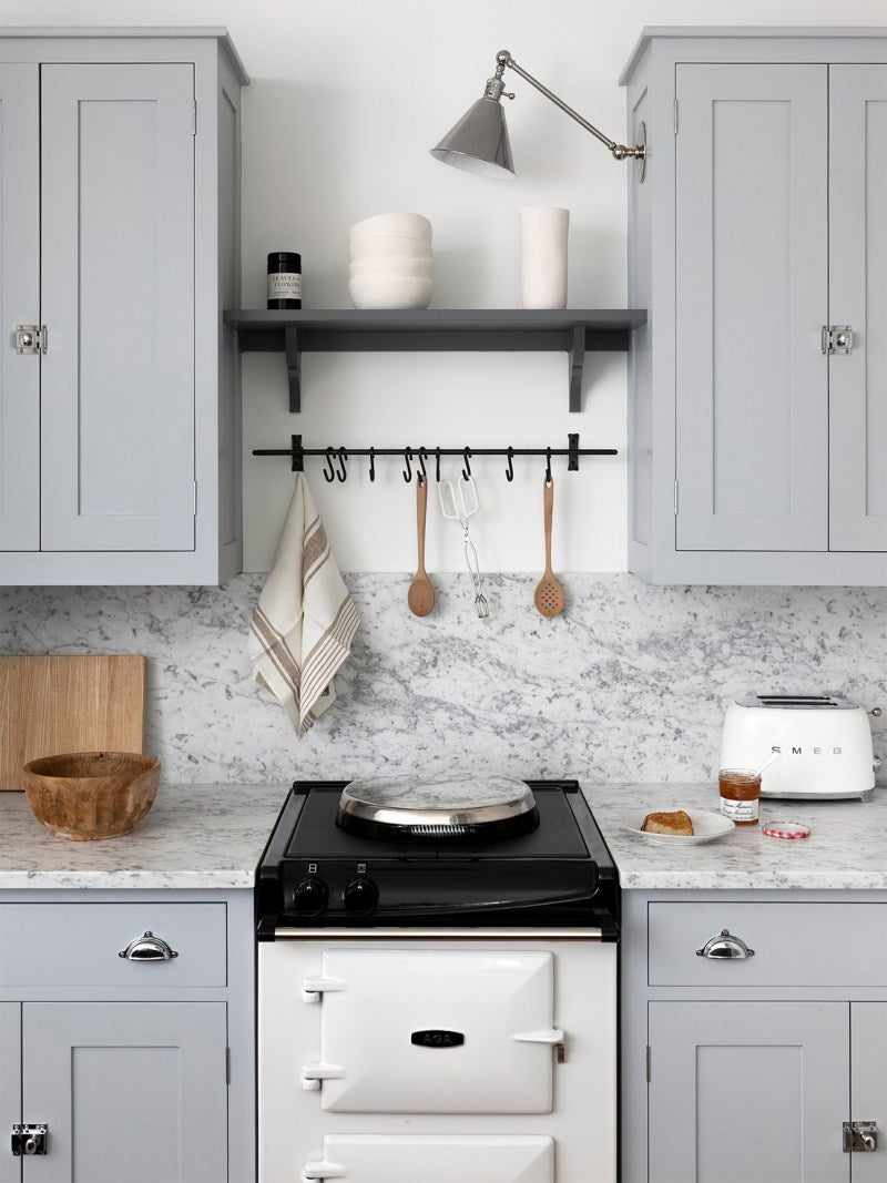 cool gray cabinets with marble backsplash and hook bar