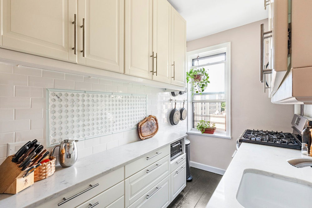 Kitchen with reclaimed floors and backsplash