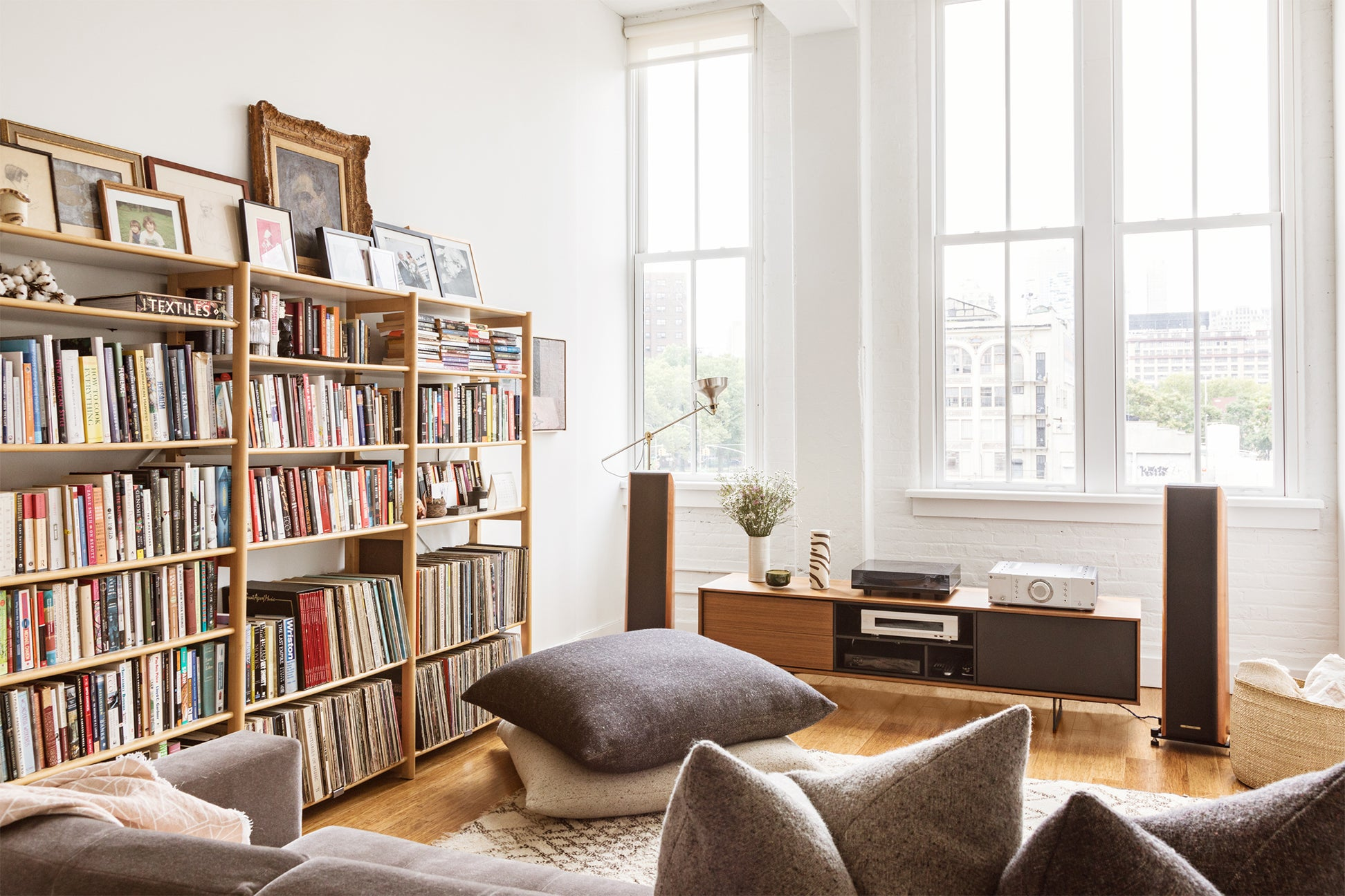 Small living room with floor pillows and bookcase