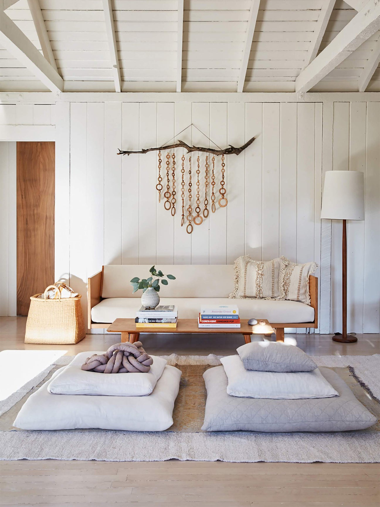 Small living room with Hans Wegner sofa and floor pillows