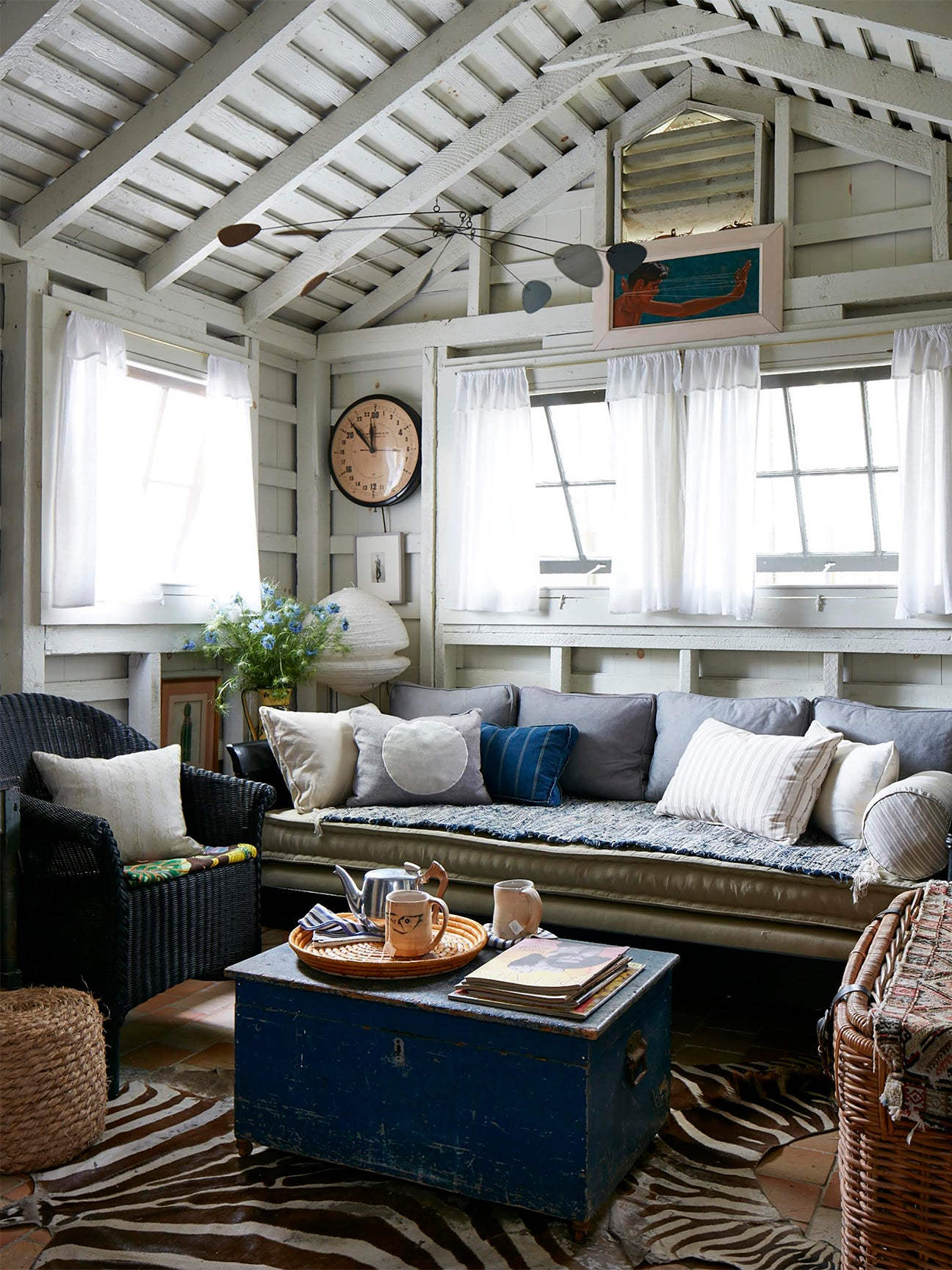 Small living room with pitched roof and multiple pillows