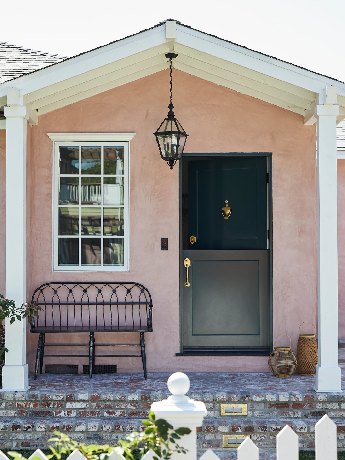 tiny pink cottage with green dutch door