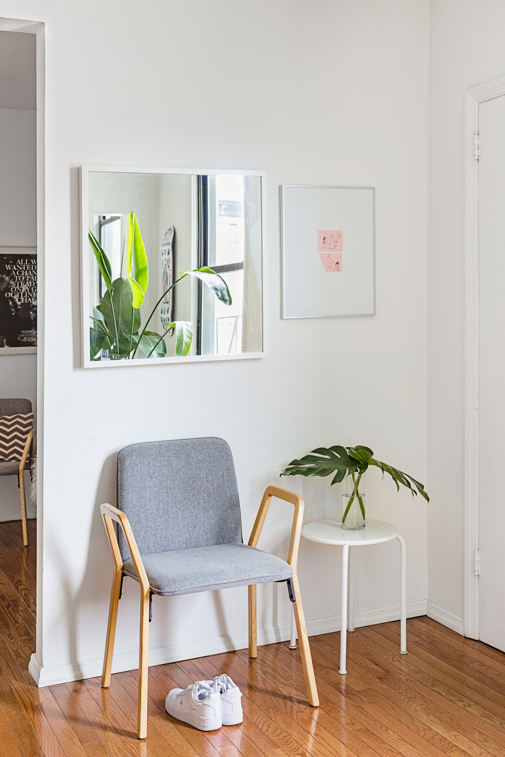 Living room with chair and white walls