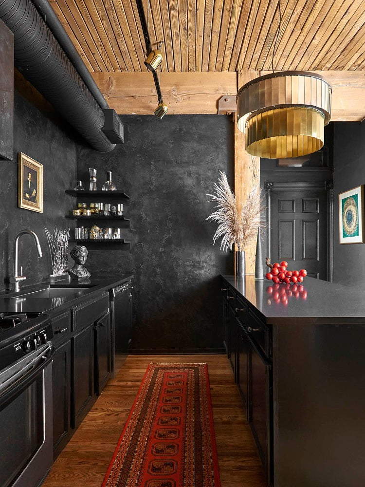 Black kitchen with red and wood accents