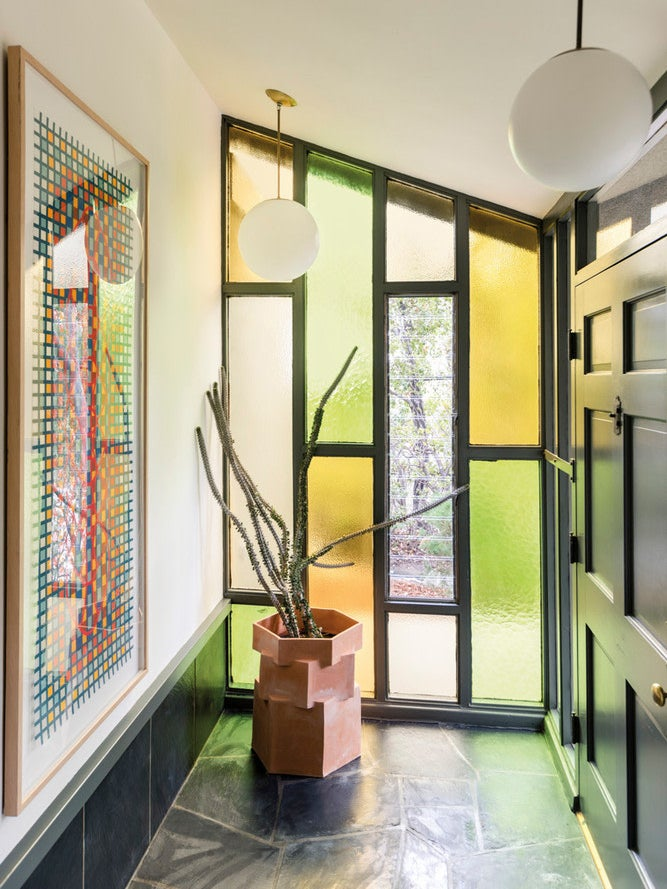 yellow and green stained glass entryway wall