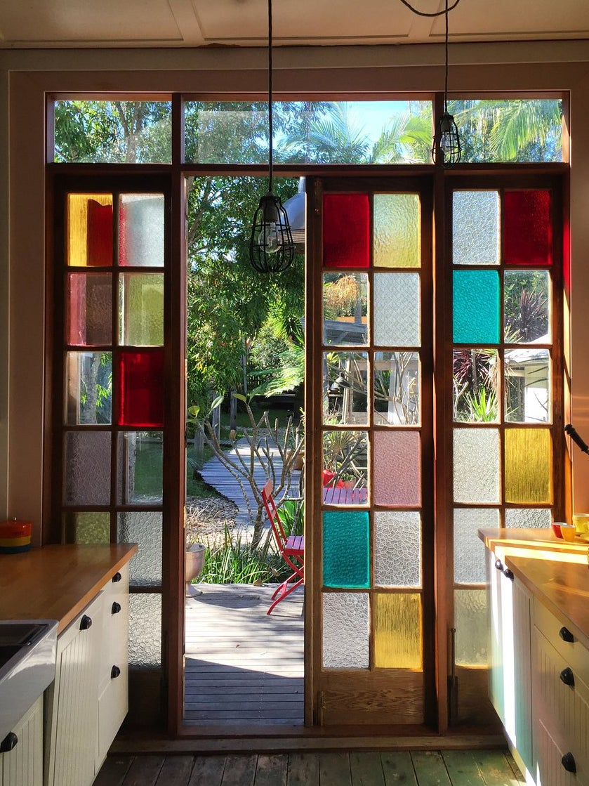colorful stained glass wall in kitchen