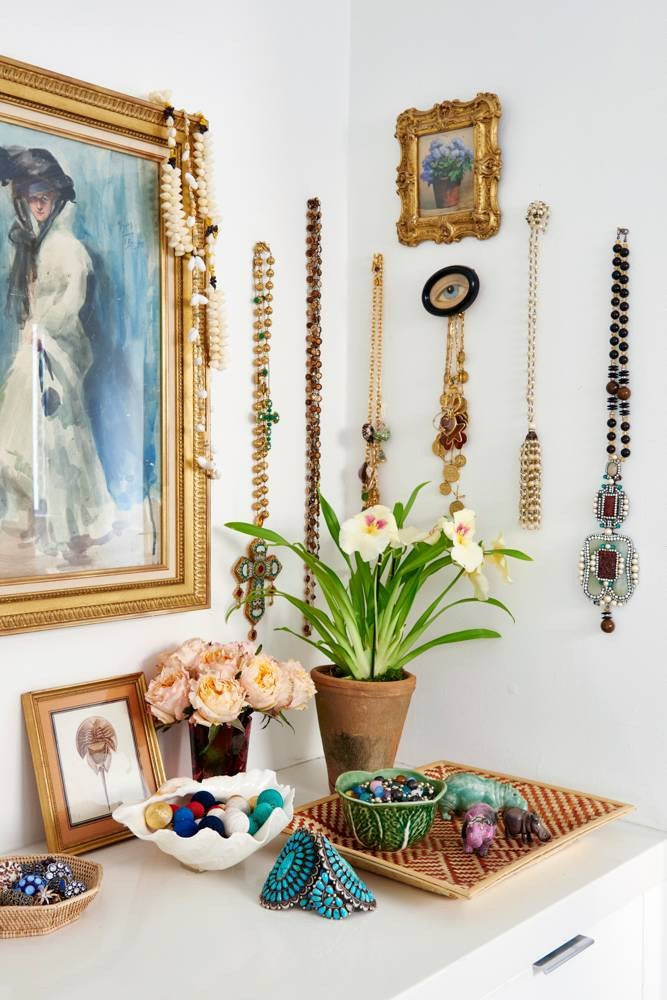 jewelry and necklaces hanging on wall hooks