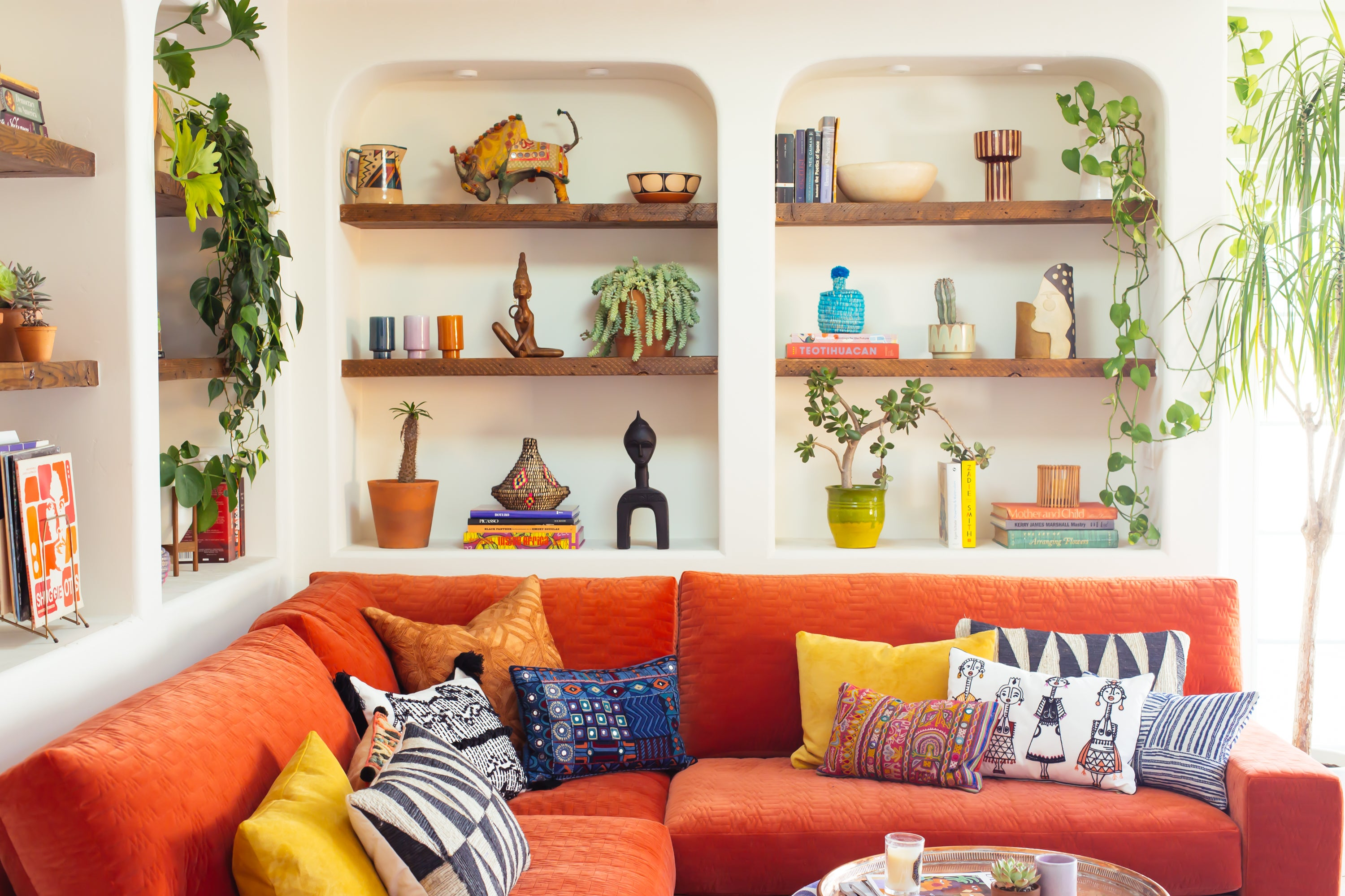 red sofa with built in bookshelves