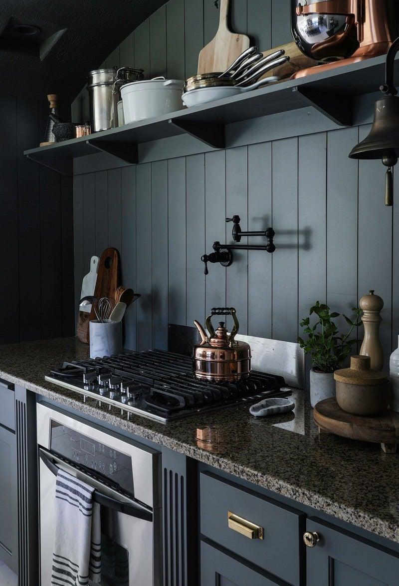 dark kitchen walls with range and open shelf