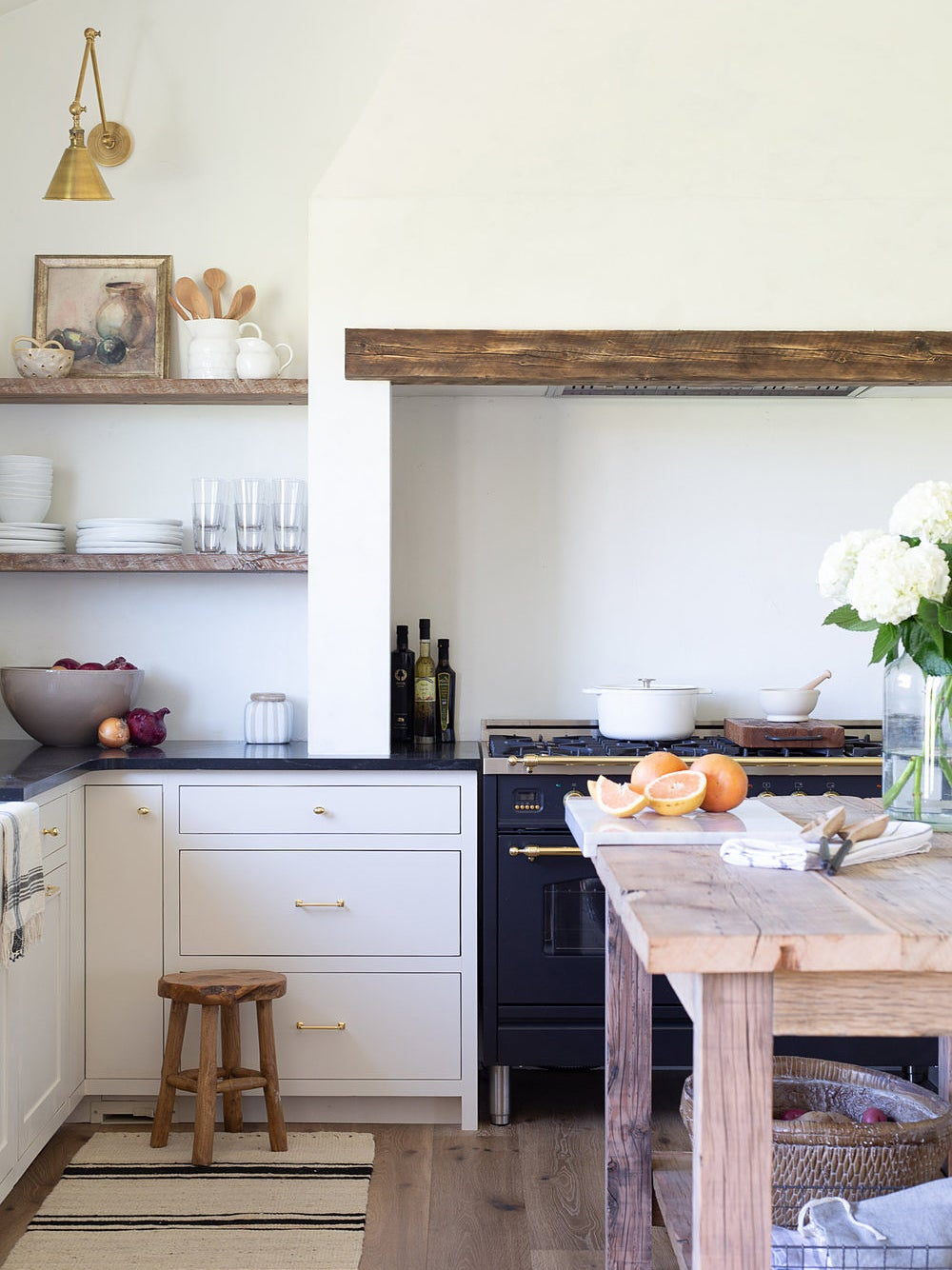 rustic white kitchen with wood slab over the range