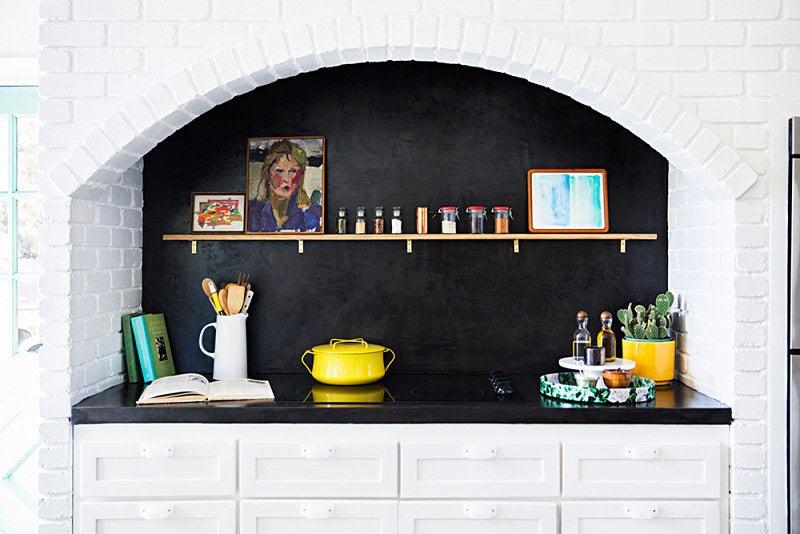 black alcove with white brick walls