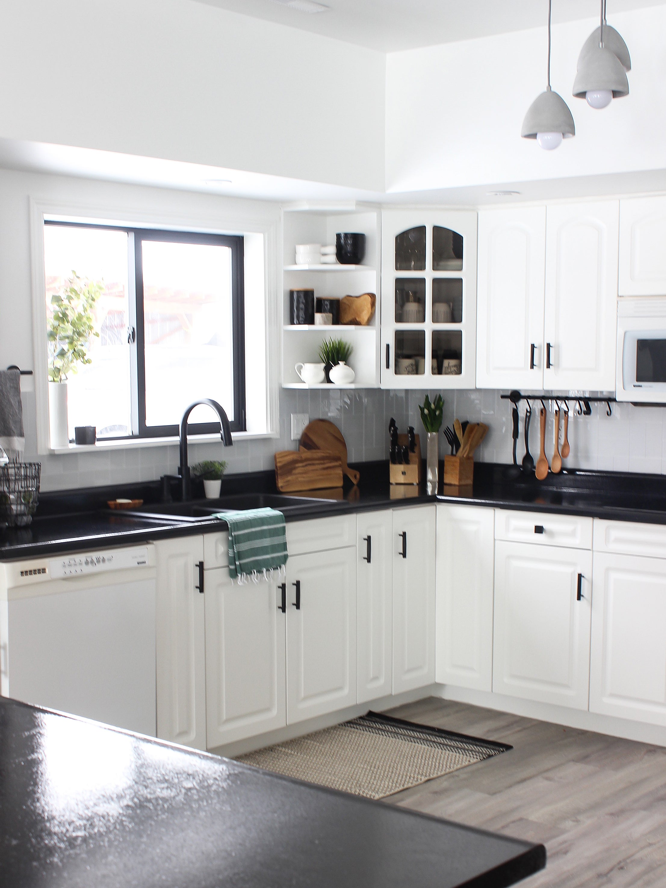 white kitchen cabinets with glass panel section
