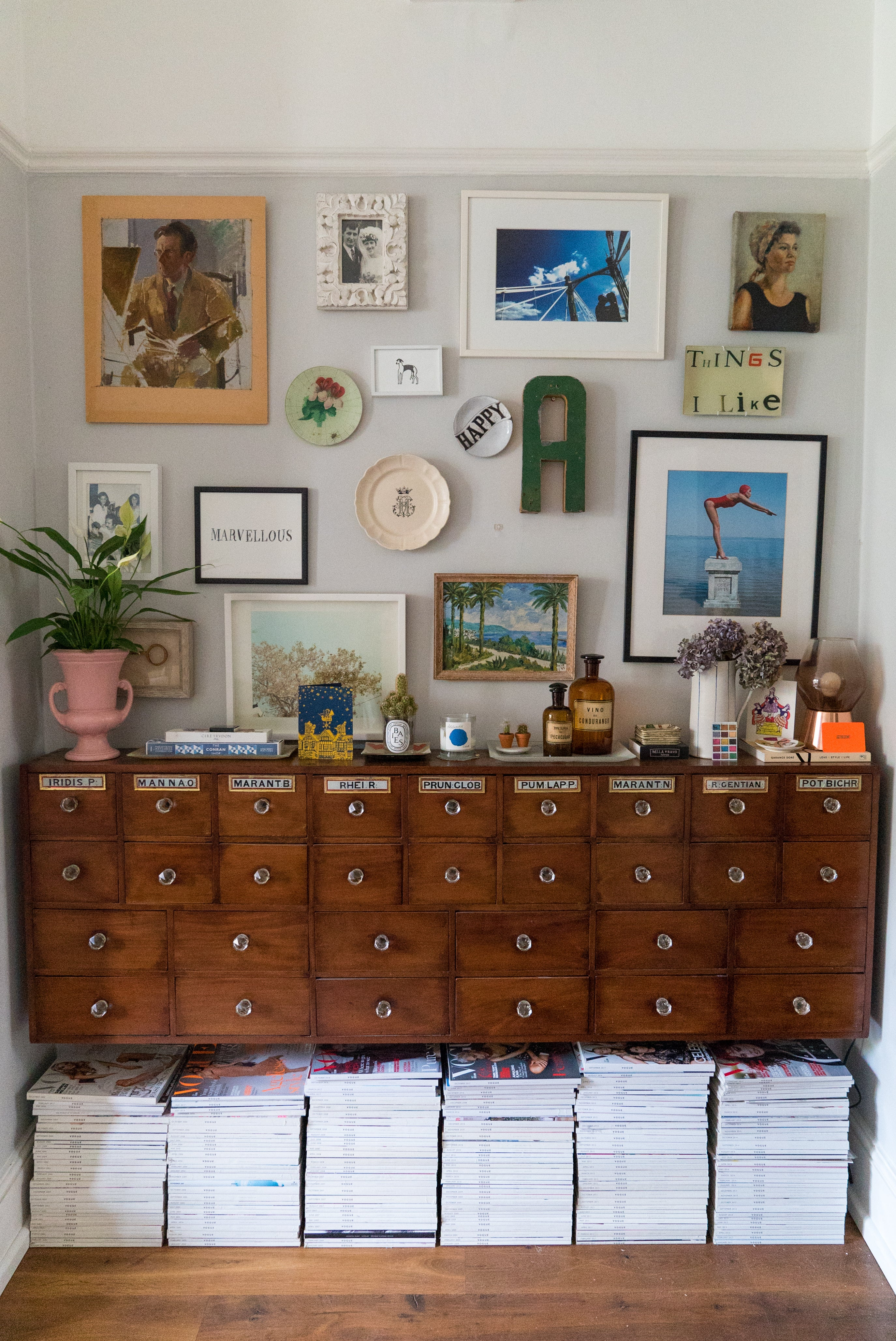 Antique cabinet with gallery wall
