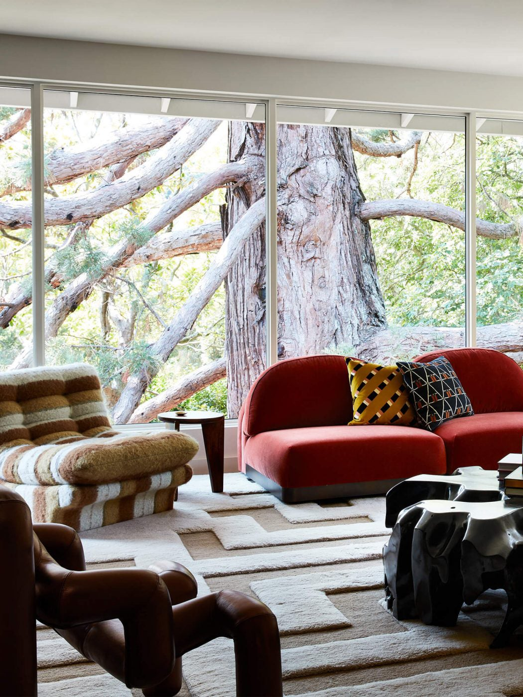 Living room with red curved velvet sectional