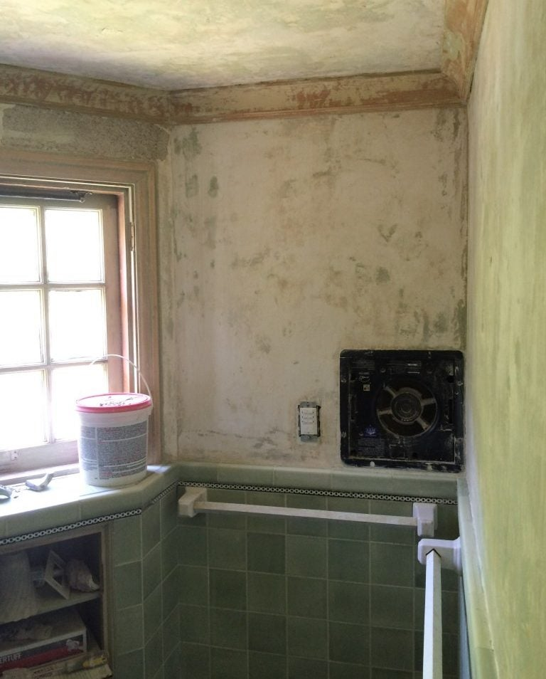 stripped walls and green tile