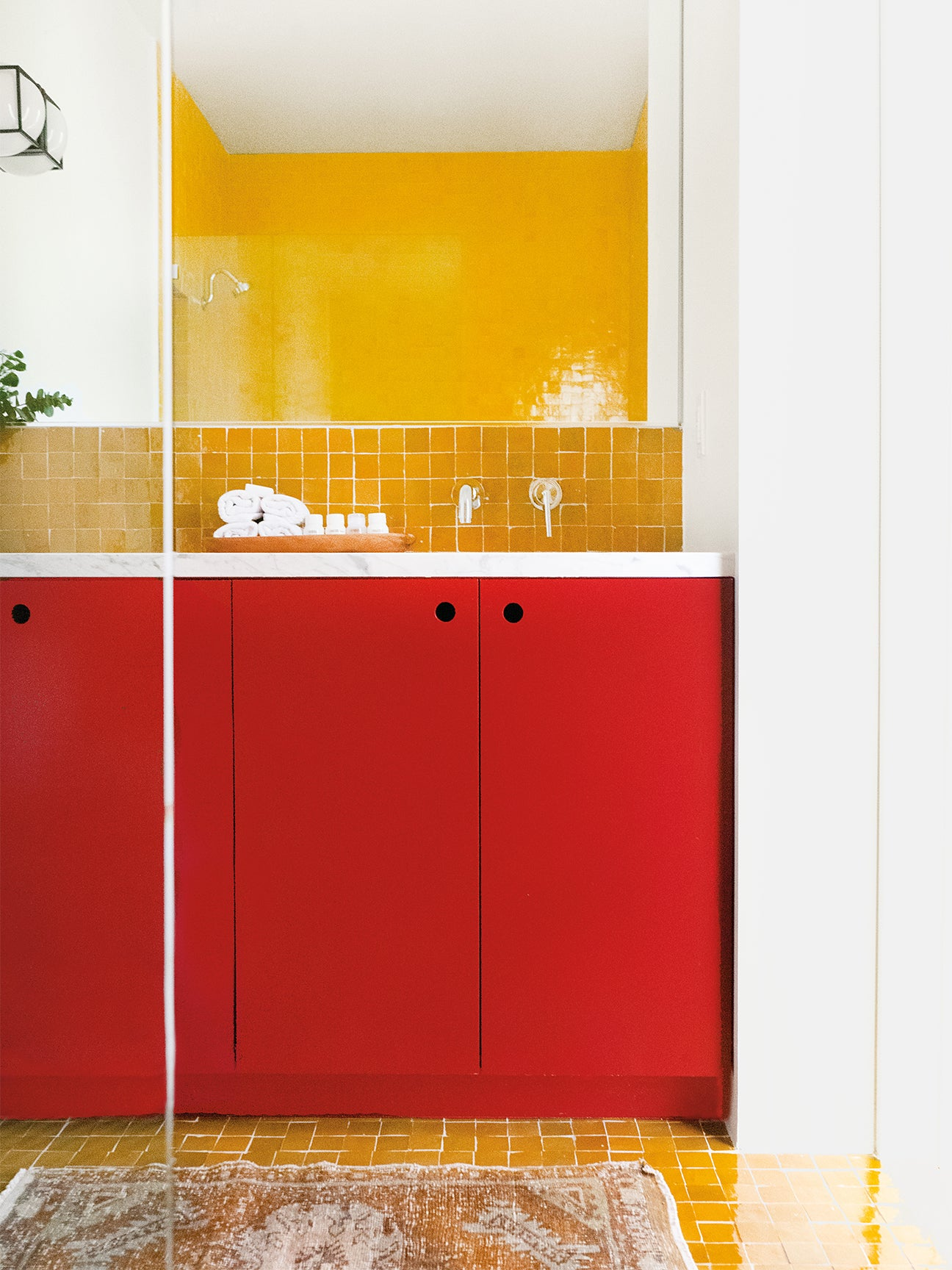 Bathroom with yellow tile and red vanity