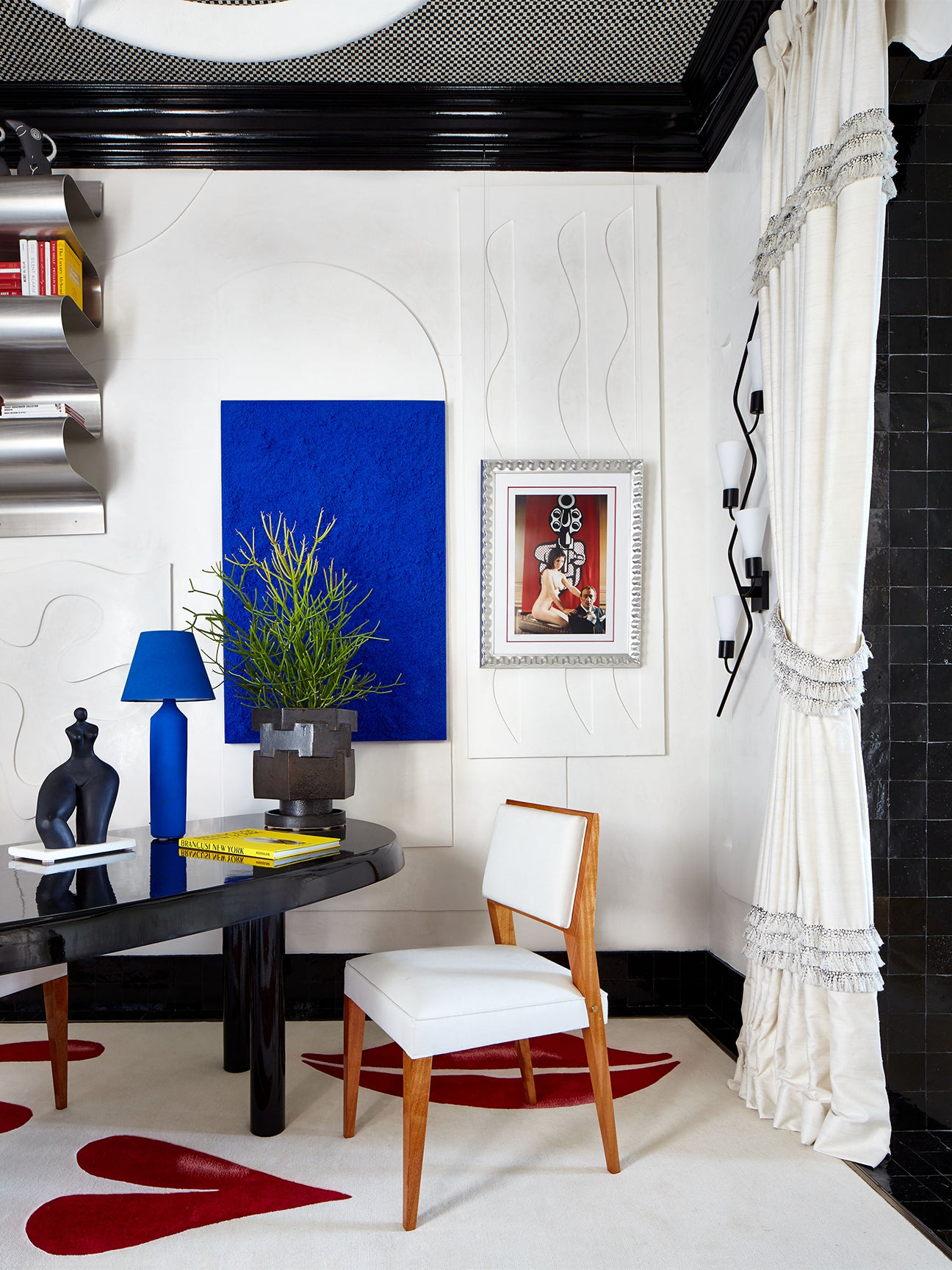 White office with Klein blue art and lamp