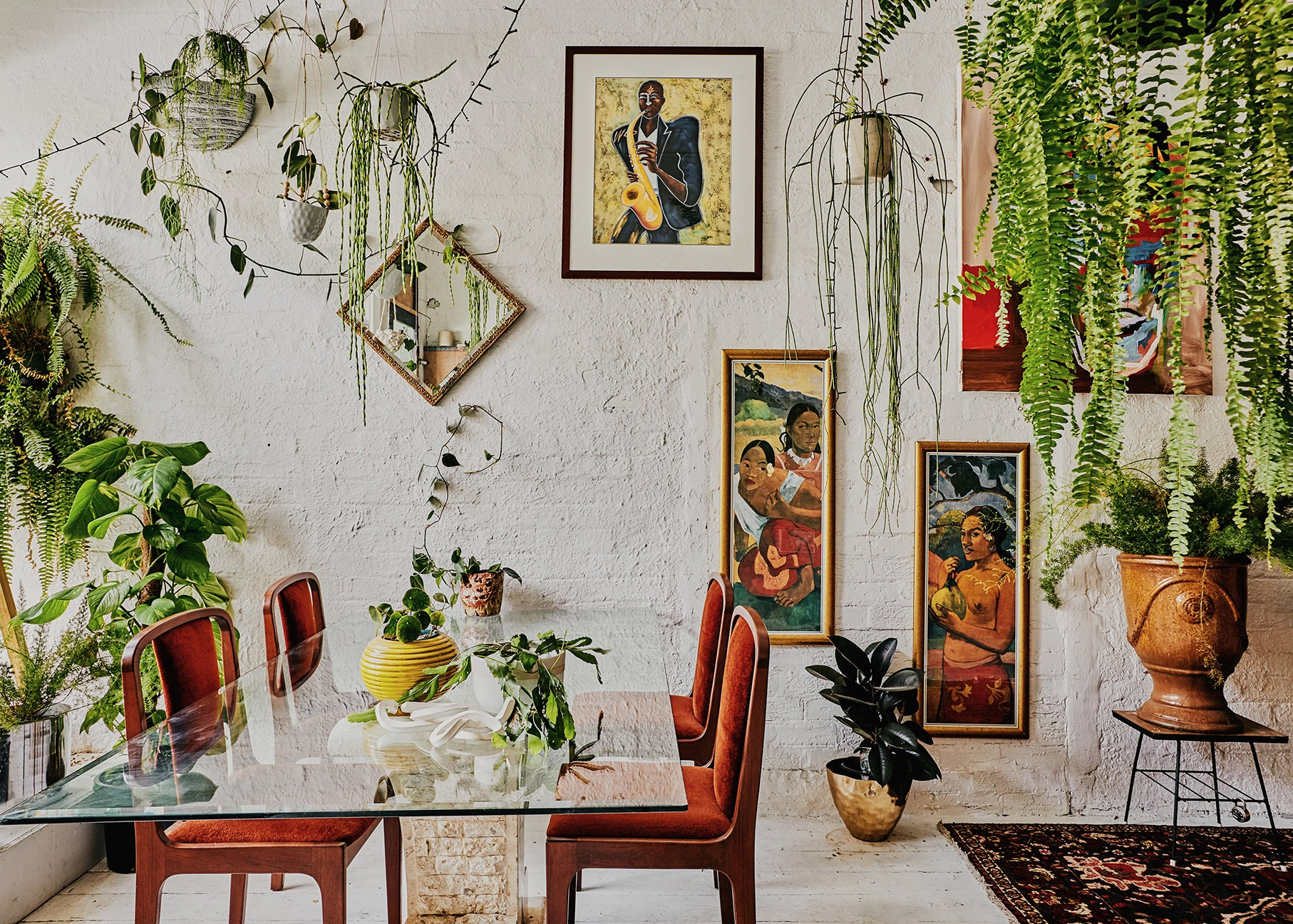 Dining room with plants and art