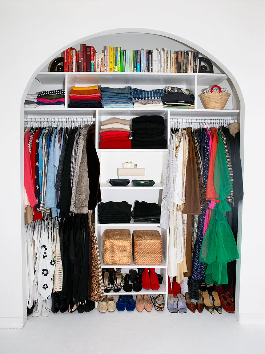 Closet with arched doors