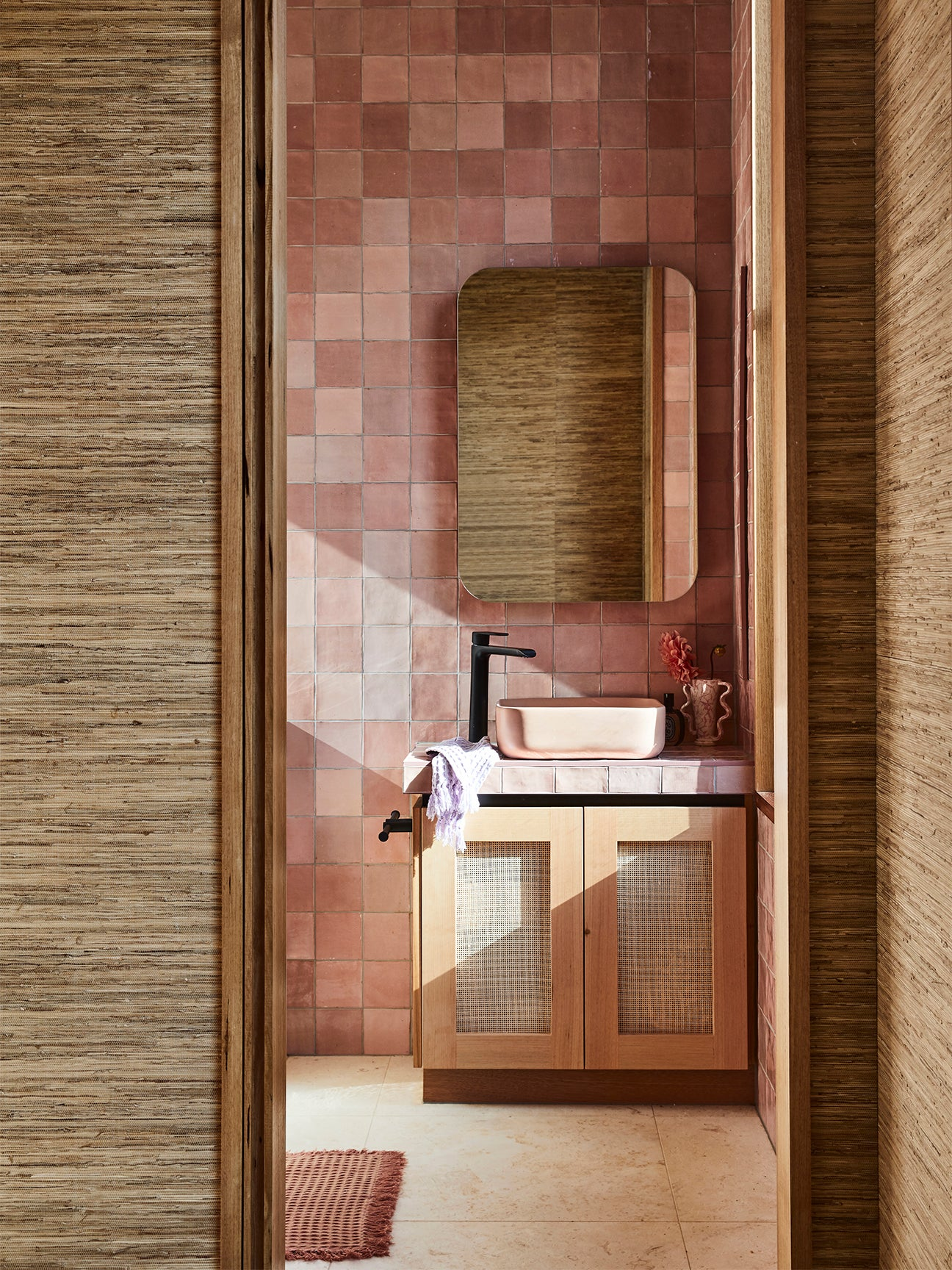 Bathroom with pink tile