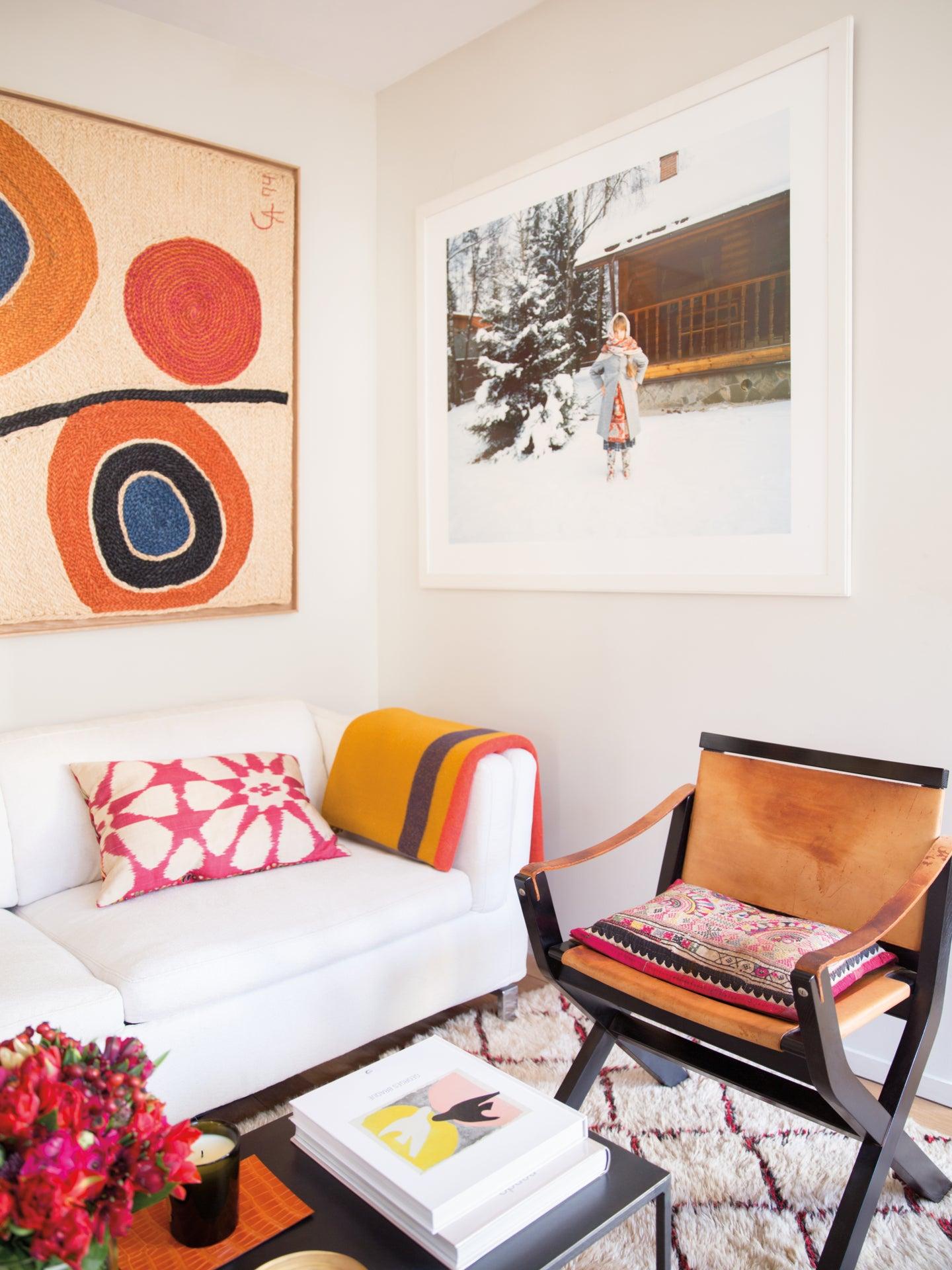 living room nook with pink and orange artwork