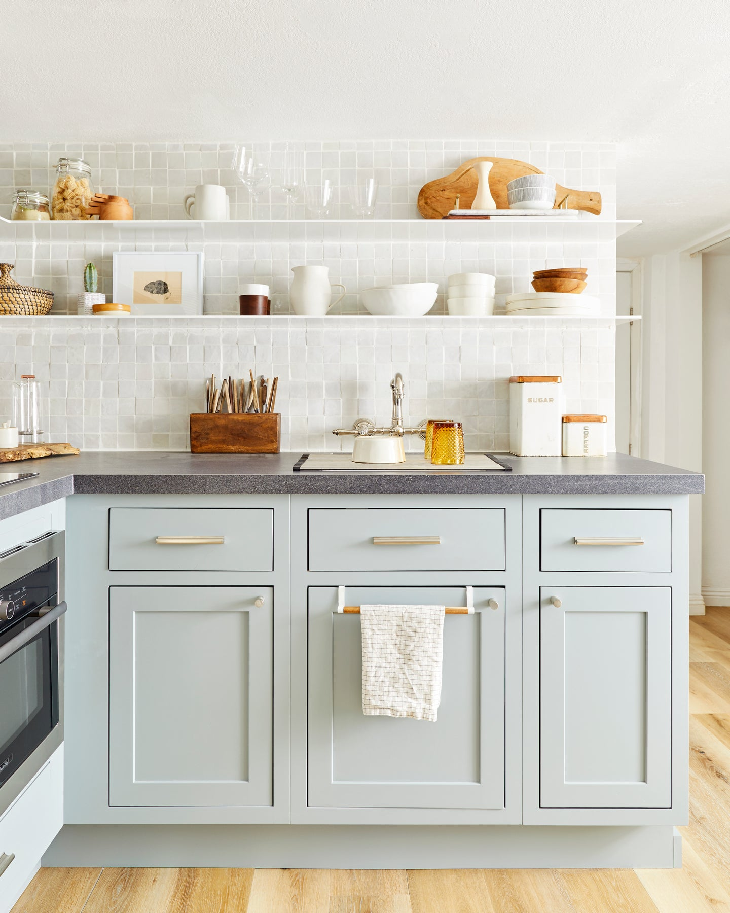 Kitchen with open shelving and mint cabinets