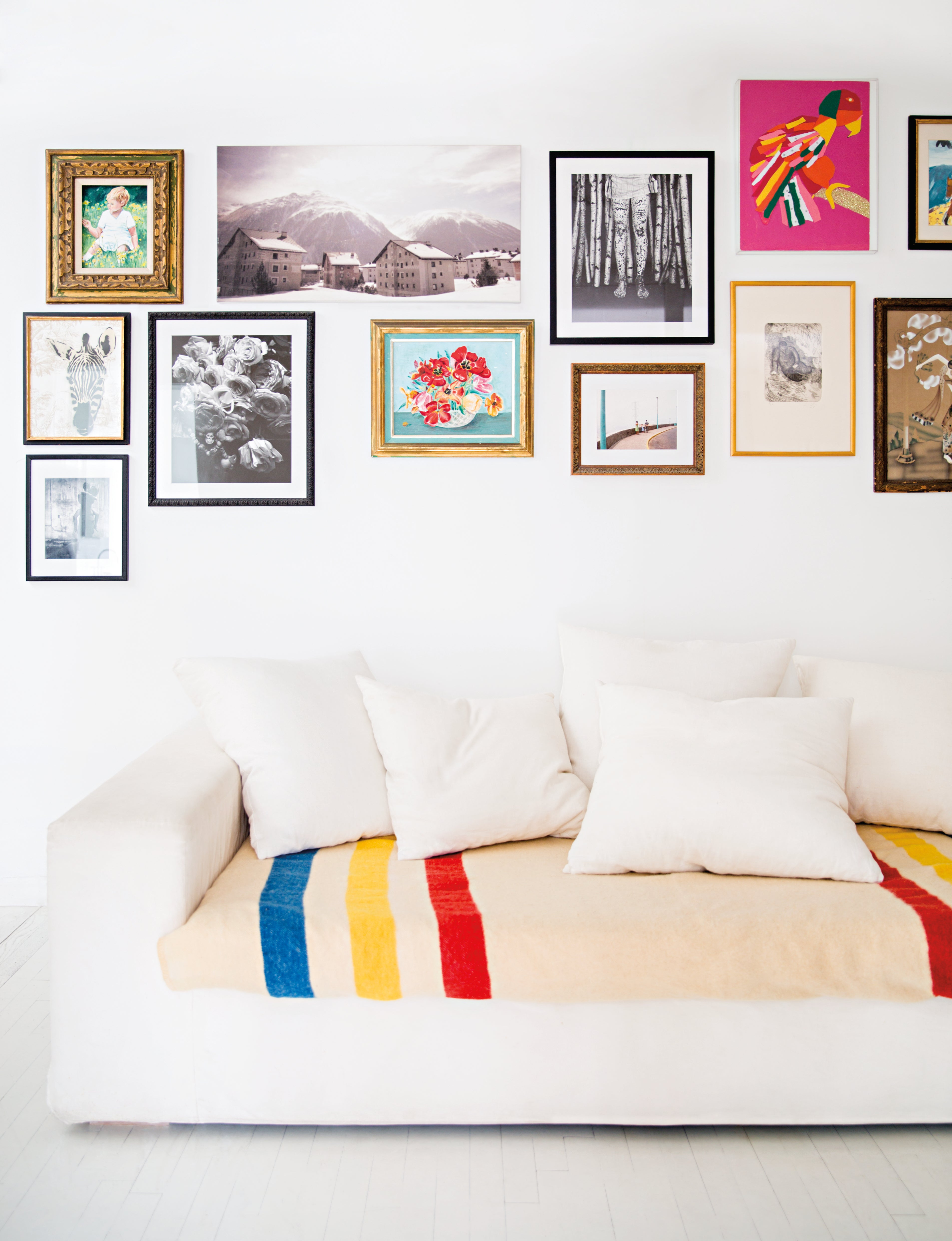 gallery wall above white sofa
