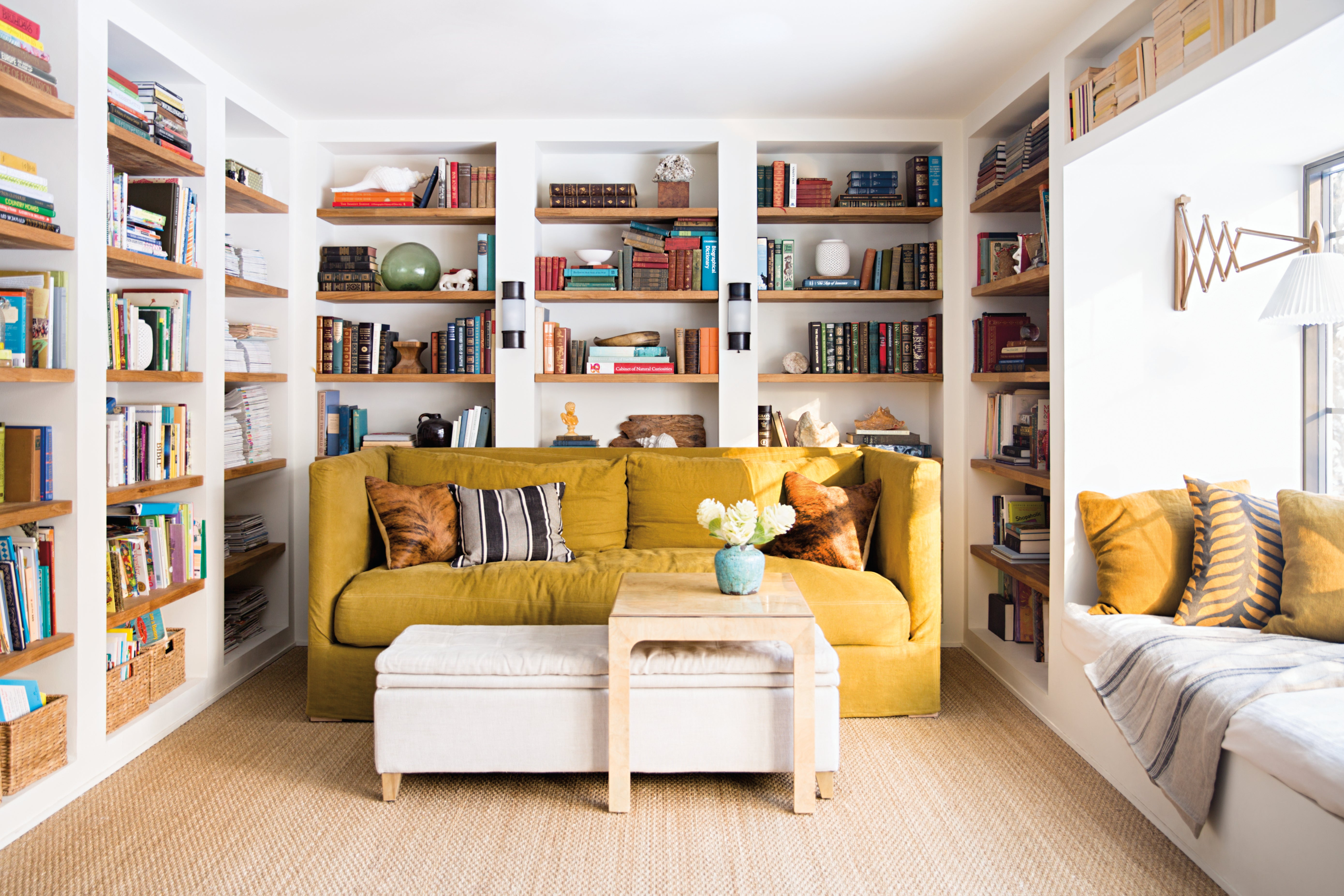 library with yellow sofa